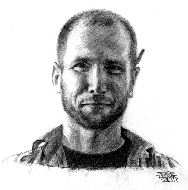 A graphite portrait of Dylan Williams, a middle aged white man with short buzzed hair and a pencil behind his ear. He's smiling gently.