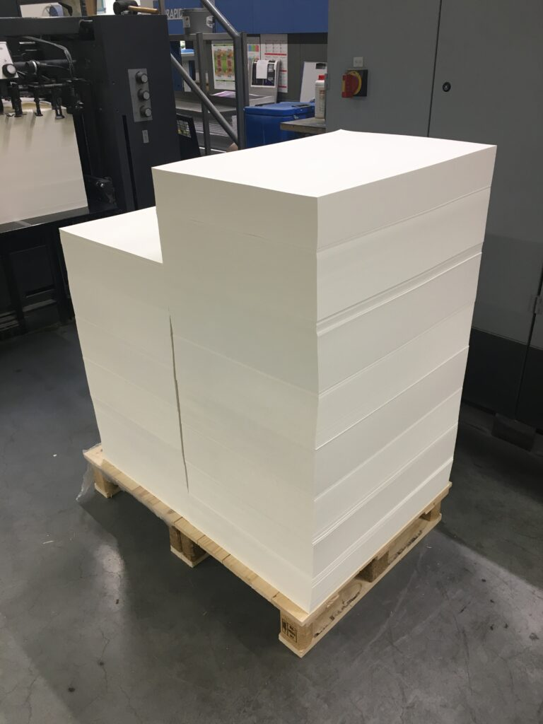 A towering pallet of pristine white paper.
